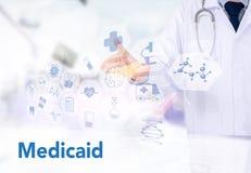 Ιατρική ασφάλεια και Medicaid και στηθοσκόπιο στοκ εικόνα