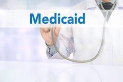 Ιατρική ασφάλεια και Medicaid και στηθοσκόπιο στοκ εικόνα με δικαίωμα ελεύθερης χρήσης