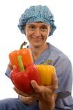 Ιατρικό θηλυκό γιατρών νοσοκόμων με τα λαχανικά Στοκ φωτογραφία με δικαίωμα ελεύθερης χρήσης