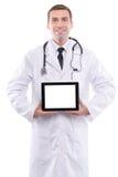 Ιατρός που παρουσιάζει ψηφιακό PC ταμπλετών με την κενή οθόνη Στοκ Φωτογραφίες