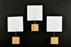 Ιεραρχία, τρεις σημειώσεις εγγράφου με το Μαύρο κατόχων για την παρουσίαση Στοκ Φωτογραφία