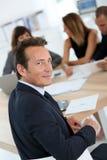 Διευθυντής επιχείρησης στη συνεδρίαση Στοκ εικόνα με δικαίωμα ελεύθερης χρήσης