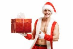 Ικανότητα Santa που δείχνει όπως ένα κόκκινο κιβώτιο Στοκ εικόνες με δικαίωμα ελεύθερης χρήσης