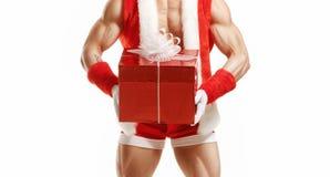 Ικανότητα Santa που κρατά ένα κόκκινο κιβώτιο Στοκ εικόνες με δικαίωμα ελεύθερης χρήσης