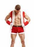 Ικανότητα Santa που παρουσιάζει ABS έξι πακέτων Στοκ Εικόνες