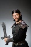 0 ιππότης με το ξίφος ενάντια Στοκ εικόνα με δικαίωμα ελεύθερης χρήσης