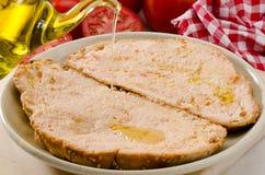 Ισπανική κουζίνα. Ψωμί ντοματών. PA amb tomaquet. Στοκ Φωτογραφίες