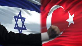 Ισραήλ εναντίον της αντιμετώπισης της Τουρκίας, διαφωνία χωρών, πυγμές στο υπόβαθρο σημαιών φιλμ μικρού μήκους