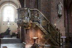 Ιστορικό pulpit στη βασιλική Archcathedral του ST Peter και του ST Paul στο Πόζναν Στοκ Φωτογραφία