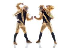 Ισχυρά νέα strippers που θέτουν στα χρυσά κοστούμια Στοκ Εικόνα