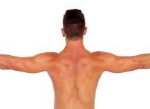 Ισχυρό αγόρι που παρουσιάζει ραχιαίους μυς του Στοκ Εικόνα