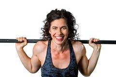 Ισχυρό θηλυκό Barbell στην πλάτη Στοκ Εικόνες