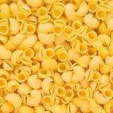 Ιταλική Macaroni Rigate σωλήνων ανασκόπηση τροφίμων ζυμαρικών ακατέργαστη ή textur Στοκ Εικόνες