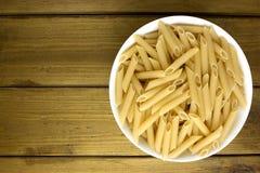 Ιταλικά ζυμαρικά penne στο πιάτο Στοκ Εικόνα