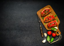 Ιταλική κουζίνα Bruschetta στη διαστημική περιοχή κειμένων αντιγράφων Στοκ Φωτογραφίες