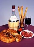 Ιταλικό κρασί με το ψωμί και το ζαμπόν Στοκ Εικόνες