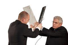 Ι επιχειρηματίες που παλεύουν με τα πληκτρολόγια Στοκ Εικόνα