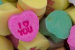 Ι καρδιά εσείς καρδιά καραμελών στο σωρό άλλων καρδιών Στοκ Εικόνες