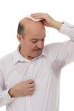 Ιδρωμένο σημείο στο πουκάμισο λόγω της θερμότητας, των ανησυχιών και της έλλειψης αυτοπεποίθησης στοκ εικόνα