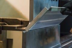 Κάμψη του μετάλλου στη μηχανή Στοκ Φωτογραφίες