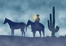 Κάουμποϋ και άλογα σε μια ομιχλώδη ημέρα Στοκ Φωτογραφία
