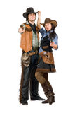 Κάουμποϋ και cowgirl με πυροβόλα όπλα Στοκ εικόνες με δικαίωμα ελεύθερης χρήσης