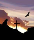 Κάουμποϋ με το σταυρό και το ηλιοβασίλεμα γραφικούς Στοκ εικόνες με δικαίωμα ελεύθερης χρήσης
