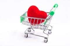 Κάρρο αγορών και κόκκινη καρδιά Στοκ Εικόνες