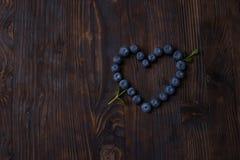Κάρτα καρδιών βακκινίων για την ημέρα βαλεντίνων του ST Στοκ Εικόνες