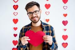 Κάρτα καρδιών εκμετάλλευσης τύπων Στοκ Φωτογραφία