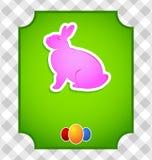 Κάρτα Πάσχας με το ζωηρόχρωμα κουνέλι και τα αυγά Στοκ Φωτογραφία