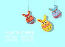 Κάρτα Πάσχας με το κείμενο τρία αυγά κουνελιών Πάσχας Στοκ Φωτογραφία
