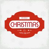 Κάρτα χαιρετισμών Χριστουγέννων με το ελαφρύ κόκκινο κείμενο υποβάθρου με το sno Στοκ Εικόνες