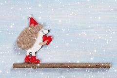 Κάρτα Χριστουγέννων με έναν σκαντζόχοιρο Στοκ Φωτογραφία