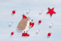 Κάρτα Χριστουγέννων με έναν σκαντζόχοιρο Στοκ Εικόνα