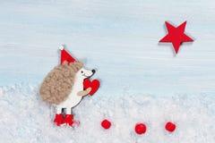 Κάρτα Χριστουγέννων με έναν σκαντζόχοιρο Στοκ εικόνα με δικαίωμα ελεύθερης χρήσης