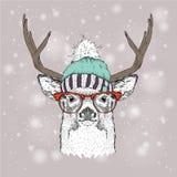 Κάρτα Χριστουγέννων με τα ελάφια στο χειμερινό καπέλο Χαρούμενα Χριστούγεννα που γράφει το σχέδιο επίσης corel σύρετε το διάνυσμα Στοκ φωτογραφία με δικαίωμα ελεύθερης χρήσης