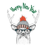 Κάρτα Χριστουγέννων με τα ελάφια στο χειμερινό καπέλο Χαρούμενα Χριστούγεννα που γράφει το σχέδιο επίσης corel σύρετε το διάνυσμα διανυσματική απεικόνιση