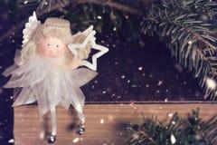 Κάρτα Χριστουγέννων με τον άγγελο Χριστουγέννων Στοκ Φωτογραφίες
