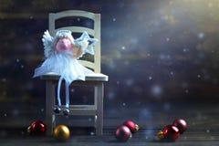 Κάρτα Χριστουγέννων με το αστέρι Χριστουγέννων εκμετάλλευσης αγγέλου Χριστουγέννων Στοκ εικόνα με δικαίωμα ελεύθερης χρήσης