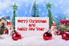 Κάρτα Χριστουγέννων με το κείμενο χαιρετισμών Στοκ Φωτογραφίες
