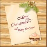 Κάρτα Χριστουγέννων με το cupcake Στοκ Φωτογραφία