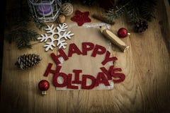 Κάρτα Χριστουγέννων, μολύβι και διακόσμηση Χριστουγέννων στο ξύλινο υπόβαθρο Στοκ Εικόνες