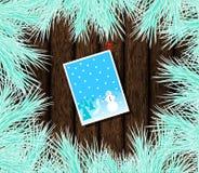 Κάρτα Χριστουγέννων που καρφώνεται στο ξύλο με το παγωμένο FIR ελεύθερη απεικόνιση δικαιώματος