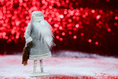 Κάρτα Χριστουγέννων σε ένα κόκκινο υπόβαθρο στοκ εικόνες