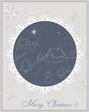 Κάρτα Χριστουγέννων - χειμερινή σκηνή νύχτας στο χωριό Στοκ Φωτογραφίες