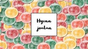 Κάρτα Χριστουγέννων joulua Hyvaa με το μπιχλιμπίδι Χριστουγέννων ως υπόβαθρο, ζουμ μέσα απόθεμα βίντεο