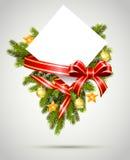 Κάρτα δώρων Χριστουγέννων με την κορδέλλα Στοκ Φωτογραφίες