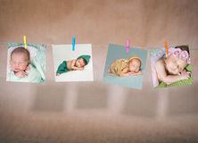 Κάρτες εγγράφου των μωρών που κρεμούν στο σχοινί Στοκ Εικόνες