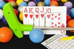 Κάρτες πόκερ και μίνι γκολφ Στοκ φωτογραφία με δικαίωμα ελεύθερης χρήσης